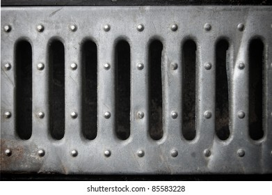 holes in a tin plate,  metal background