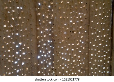 Holes in wood Board, wood Board background. Wooden Board with lots of