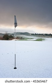 Holeside view on a golf course in Scotland on a snowy winter morning.