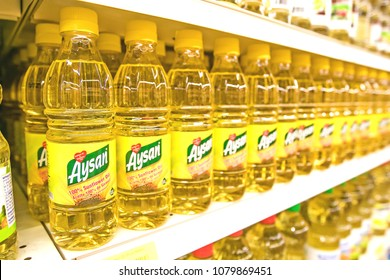 Holetown, Barbados, 03/19/2018: Bottles of Aysan sunflower oil stand on a shelf of a local supermarket.