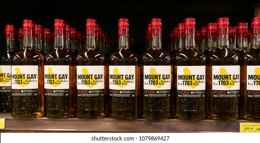 Holetown, Barbados, 03/19/2018: Bottles of Mount Gay Eclipse rum stand on a shelf of a local supermarket.
