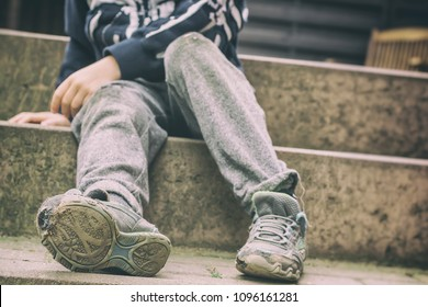 Holey shoes as a symbol of a childhood in social disadvantage