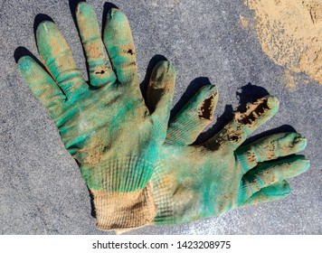 Holey working gloves at a construction site at home .