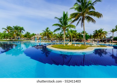 Holguin Province, Playa Pesquero Hotel, Cuba, Aug. 31, 2016, amazing gorgeous inviting view of luxury swimming pool and hotel grounds in tropical garden in early morning time