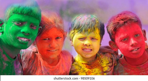 Holi celebrations - Group of kids playing Holi in India.