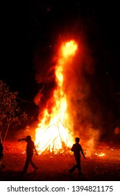 Holi celebrations start on the night before Holi with a Holika Dahan where people gather, perform religious rituals in front of the bonfire, and pray that their internal evil be destroyed .