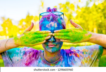 Holi Colorful festival of colored paints of powders and dust. People covered with colored powder rejoice celebrate and dance. Holiday bright colors for the entertainment of people.