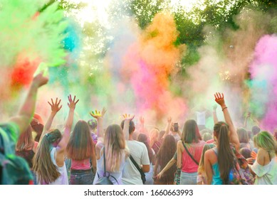 Holi festival of color. Holi colorful festival of colored paints of powders and dust. People covered with colored powder rejoice celebrate and dance.
