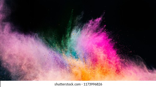 Holi powder blowing up on black background. Holi, festival of colors. Banner.