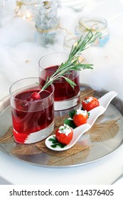 Holiday appetizer. Cranberry cocktail  and  cherry tomatoes stuffed with goat cheese