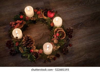 Holiday background with Advent wreath. Christmas lights