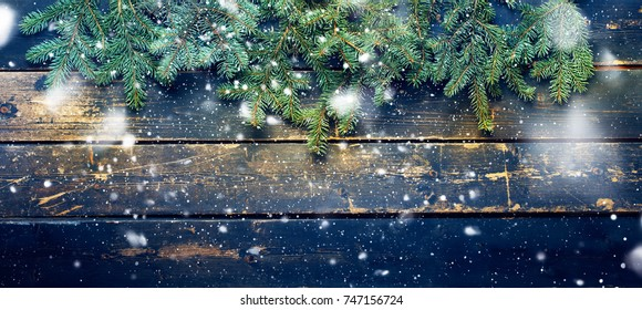 Holiday Banner Green Christmas Natural Fir Spruce on Dark Wooden Planks Vintage Background Happy New Year Greeting Card Winter Xmas Theme Copy Space for Text. Drawing Snowfall