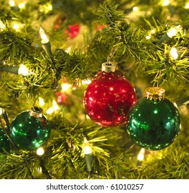 Holiday baubles hanging on Fir tree with sparkling lights