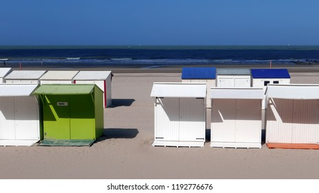 Holiday beach cabins in summer on the beach of Blankenberge, Belgium.