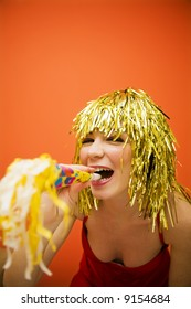 Holiday: beautiful girl having fun at a carnival party