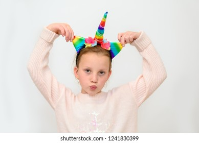 Holiday. Beautiful Teen In Unicorn Costume Celebrating New Year, Christmas, Purim, Birhtday. Portrait Of Happy Little Girl  In Festive Carnival Masks Having Fun At Party.