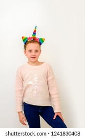 Holiday. Beautiful Teen In Unicorn Costume Celebrating New Year, Christmas, Purim, Birhtday. Portrait Of Happy Little Girl In Colorful Carnival Unicorn Headband Having Fun At Party.