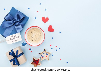 Holiday breakfast on Happy Fathers Day with coffee, gift or present  box and heart on table top view. Flat lay.