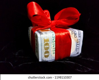 holiday card. cash gift.  money on a black background.