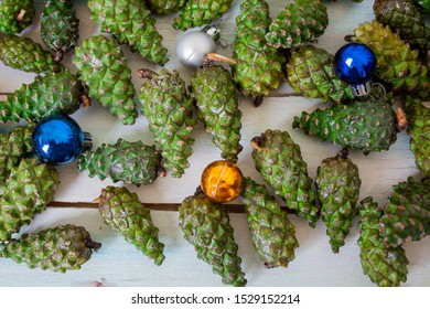 Holiday Christmas background. Christmas card background with pine cones decoration. Cones and balls, background decoration