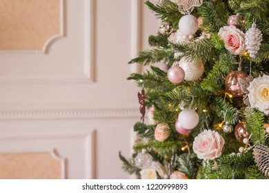 Holiday Christmas Gifts with Boxes and Balls, Pine Cones, Wallnuts, Fir Tree Toys.Pastel decoration for christmas tree. Fantasy living room for christmas.Pink and silver ornaments.Family winter