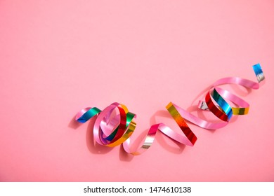 holiday colorful ribbons on pink background