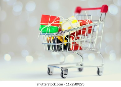 Holiday Concept: Shopping Trolley Filled with, Christmas Gifts