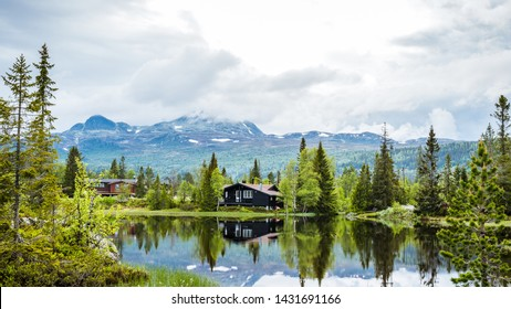 Holiday cottages on the lake in the mountains in Norway, Scandinavia