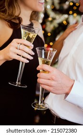 Holiday: Couple Holding Glasses Of Champagne