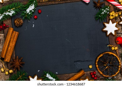 Holiday Decorations Christmas and New year Theme Background on Black Chalkboard with space for text. Selective focus.
