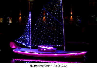 holiday decorations are on display as lighted boats in the carroll creek that runs in the middle of frederick md. Beautiful holiday decorations in the town of frederick
