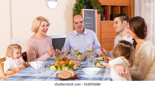Holiday dinner in the bosom of beautiful family indoor