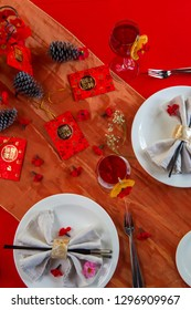 """Holiday dinner. Chinese New Year dinner place setting with decorations. Translation on greeting card: """"Happy lunar New Year"""""""