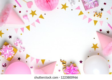 Holiday frame or background with balloon, gift, confetti, golden star, carnival cap and streamer. Invitation, birthday, bachelorette party, baby shower concept.  Copy space.