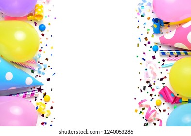 Holiday frame or background with colorful balloon, confetti and carnival cap. Top view. Birthday or party greeting card with copy space.