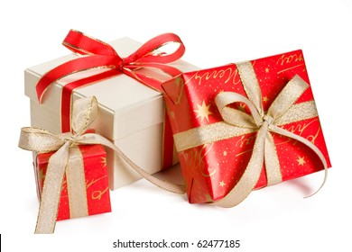 Holiday gift boxes decorated with ribbon isolated on white background.