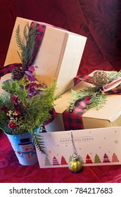 holiday gifts attached with ribbons in holiday theme with matching decor and greeting card with ornament