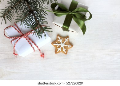 holiday gifts and ginger star at real green tree / Merry Christmas and Happy New Year