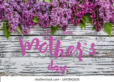 Holiday greetings card with lilac flowers and hand lettering text Happy Mothers Day