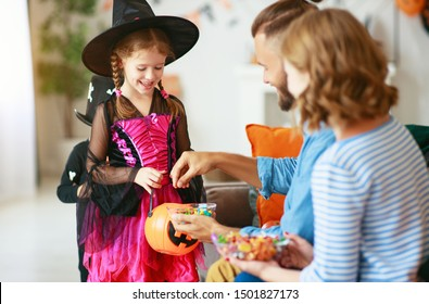 holiday of Halloween. children ask their parents for candy in costumes