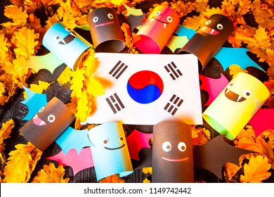 Holiday Halloween. Korea. Autumn holiday. Vampires against the background of yellow leaves. Decoration for the holiday of Halloween in Korea. the flag of the Republic of Korea.
