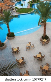 Holiday hotel and beautiful swimming pool with cafe and palms
