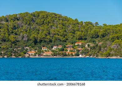 Holiday houses at Veliko Jezero in Mljet national park in Croatia - Shutterstock ID 2006678168