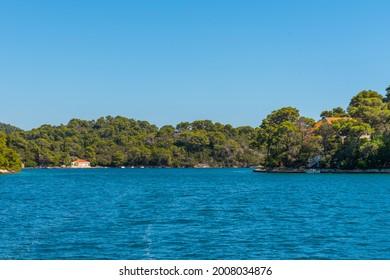 Holiday houses at Veliko Jezero in Mljet national park in Croatia - Shutterstock ID 2008034876