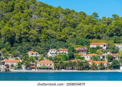 Holiday houses at Veliko Jezero in Mljet national park in Croatia - Shutterstock ID 2008034879
