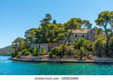 Holiday houses at Veliko Jezero in Mljet national park in Croatia - Shutterstock ID 2008034885