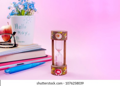 Holiday of Labor and Peace in May. Notepad with text, glasses, hourglass and spring flowers. Free space for text