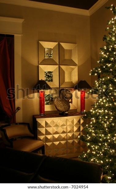 Holiday living room lit by two lamps and Christmas tree