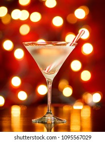 Holiday Martini with candy cane, Christmas lights and ornaments