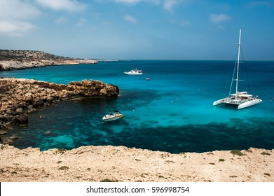 Holiday at the Mediterranean sea in Europe. Clean sea water. Beautiful coastline. Blue lagoon. European resort. Cruise travel in Europe. Eurotrip. Cruise tour. Yacht at sea. Trip abroad